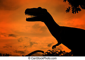 the silhouettes of dinosaurs