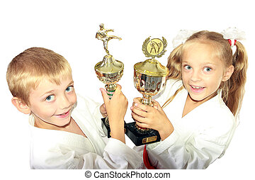 Boy and girl in a kimono with a championship winning in the...