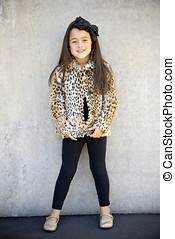 Happy little girl - Cute little girl modeling a leopard...