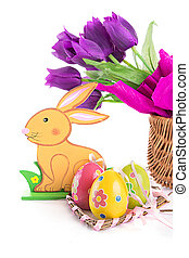 Easter decoration with rabbit, eggs and tulips