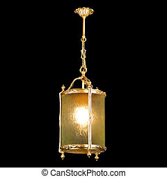 Vintage chandelier isolated on black background with...