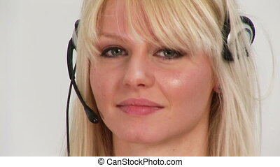HD footage of a woman on a headset - 1920x 1080 footage of a...