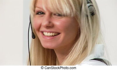 HD footage of a woman on a headset 2 - 1080i footage of of a...