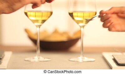 couple toasting with wine at restau - couple toasting with...