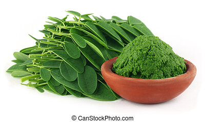 Moringa leaves with paste on a brown bowl