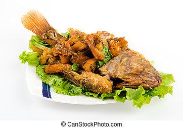 Thai food fried fish in white plate isolated on white...