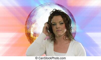 Disco Dancing - Woman disco dancing with Disco ball in...