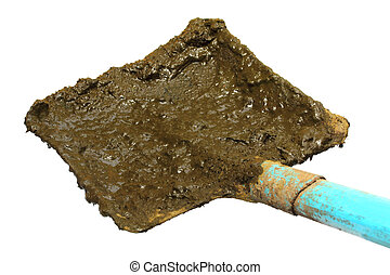 Shovel for taking raw cow manure over white background