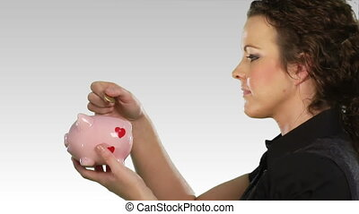 Savings money in a piggy bank - High Definitin footage of a...