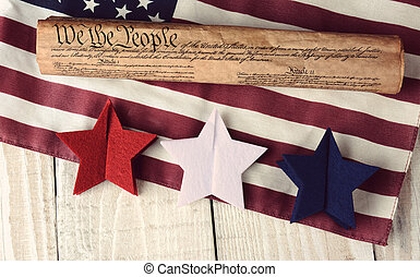 Constitution Flag and Stars - A rolled up US Constitution on...