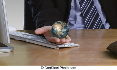 Businessman with a rotary globe on his open hand