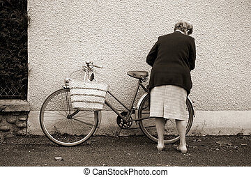bike - Old lady with bicycle in Argentat market , Correze,...