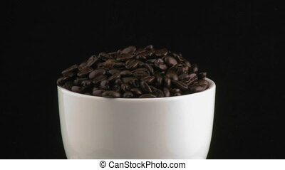 Cup with beans rotating