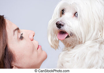 Maltese dog and owner