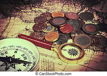card with coins - compass and magnifying glass gold color on...