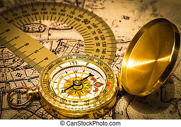 Compass on a card - The compass and protractor lies on an...