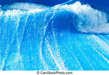 Blue surfing wave in sunny day