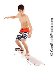 young surfer simulate surfing pose