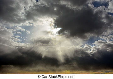 Sun through the stormy clouds. Picture can be used as a...