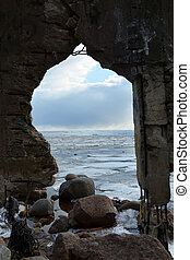 Frozen sea through the arch