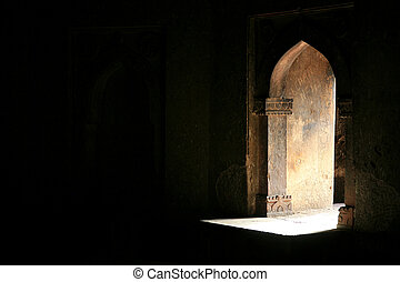 opening - Light shining through a window of a tomb monument,...