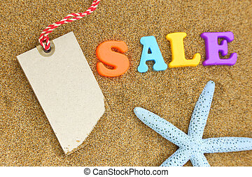 Blank tag, colorful sale text and starfish on sand