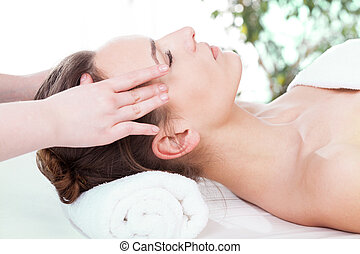 Woman having head massage - Beautiful woman having relaxing...