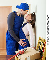 Two workers in uniform flirting - Two smiling workers in...