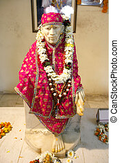 sai baba - Sai Baba statue in Hanuman temple in delhi, india