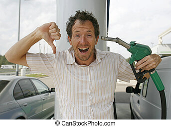 petrol pump - Man happy about decreasing petrol prices