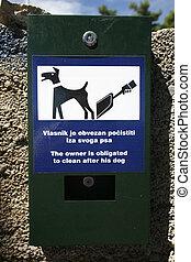 dog poo - Plastic bag dispenser for dog poo in park