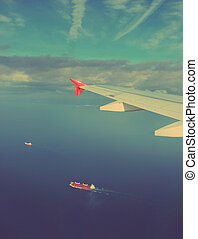 ships under wing of plane - vintage retro style