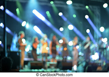 Defocused concert on stage colorful illuminated - Defocused...