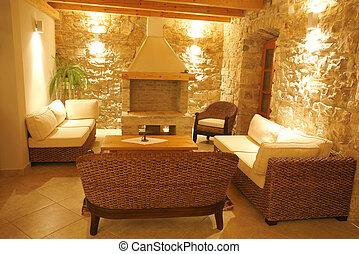 Luxury stone villa interior illuminated at night