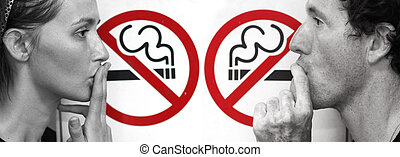stop smoking - couple smoking a no smoking sign