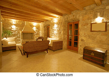 Luxury stone villa interior illuminated at night