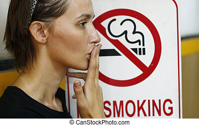 stop smoking - Lady smoking a non-smoking panel