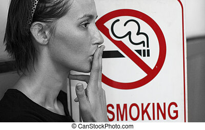 stop smoking - Lady smoking a non-smoking panel, colour...
