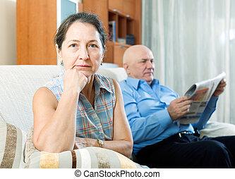 Family conflict - Portrait of sad mature woman against...