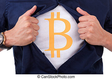 Young businessman opening his shirt and showing bitcoin...