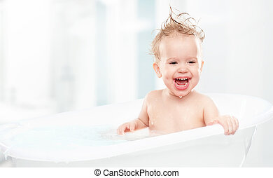 happy funny baby laughing and bathed in bath - happy funny...