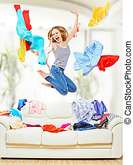 Funny girl with flying clothes jumping at home - Funny happy...