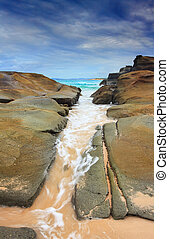 Steadfast, Sea wash through rock crevice - The ocean washes...