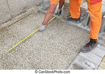 Construction site, brick paver measure