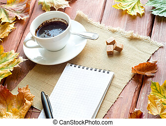autumn stillife - Cup of coffee and sugar on wooden table