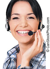 Helpline operator - Smiling female helpline operator with...
