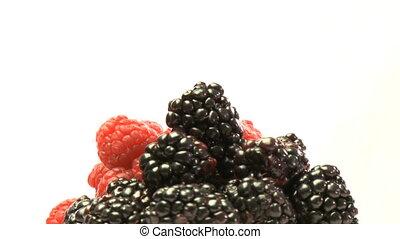 Cluster of rasberries and blackberries - Pile of rasberries...