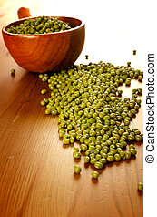 Soybeans in a wooden spoon - Green soybeans on wooden...