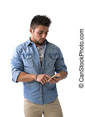 Attractive young man typing on smartphone, sending text message