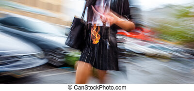 Abstract image of a woman walking down the street...